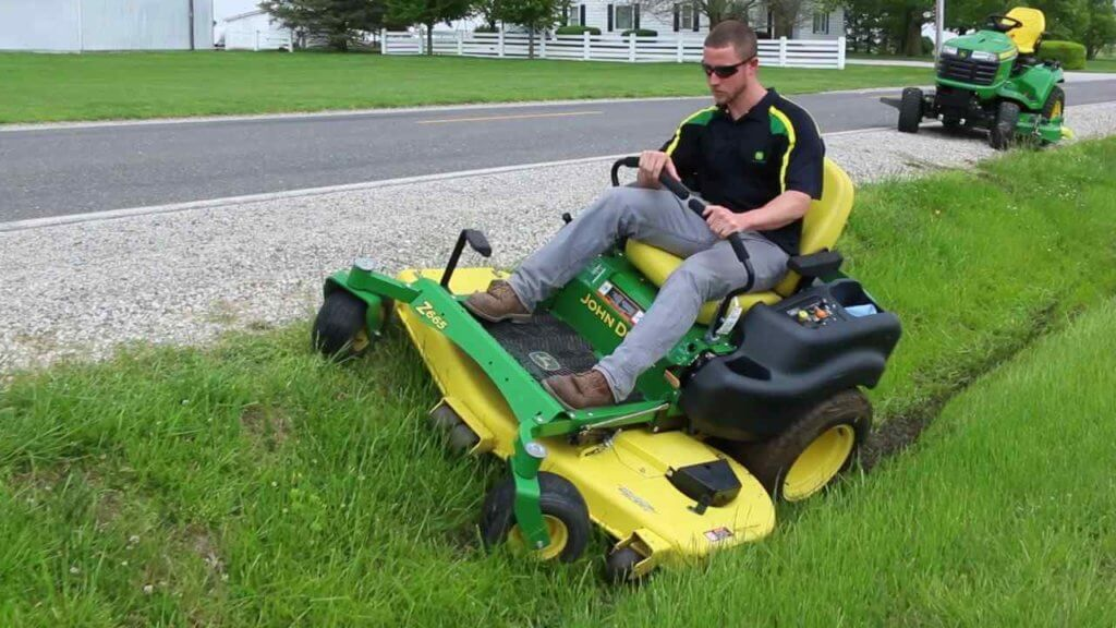 Lawn mowers for steep banks